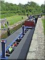 SJ9312 : Working boat in Otherton Lock, Staffordshire by Roger  Kidd