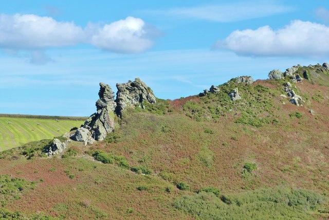 Long lens shot of Hazel Tor from the SW Coast Path on Cathole Point, South Devon
