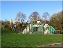 TL3949 : Barrington: playground and church tower by John Sutton