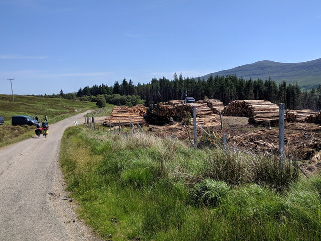Cyclists and logging on the B873, heading east