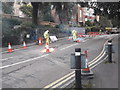 SZ0891 : Bournemouth: removing white lines on St. Stephen's Road by Chris Downer