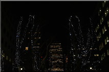 TQ3780 : View of One Canada Square between the trees on West India Avenue by Robert Lamb