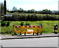 SS7698 : Yellow temporary barriers, Neath Road, Tonna by Jaggery
