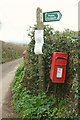 SX8974 : Sign and postbox, Ashwell by Derek Harper