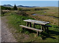 SN8127 : Picnic bench next to the Afon Wysg/River Usk by Mat Fascione