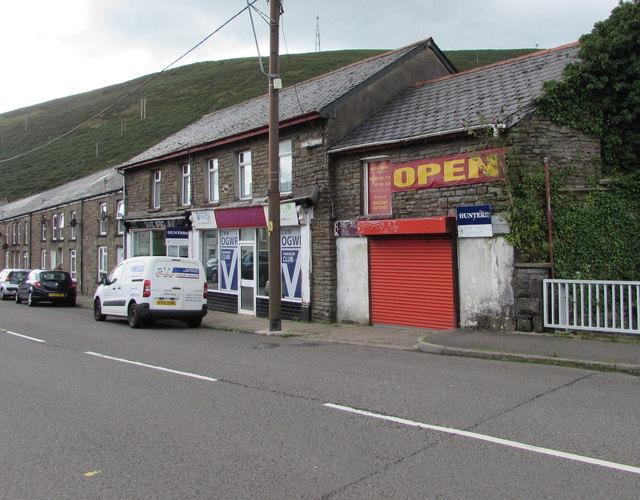OPEN banner on a shuttered shop, Bridge Street, Ogmore Vale
