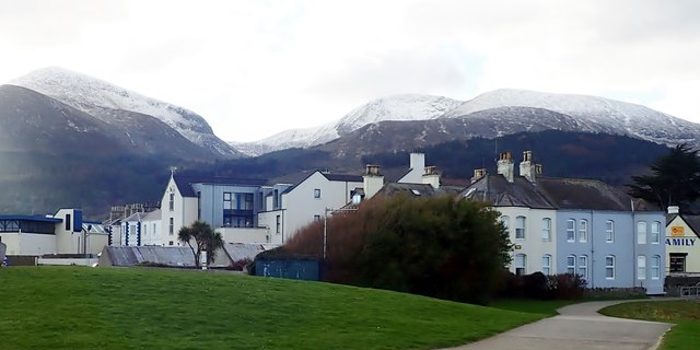 Castle House, the SVP Hostel and the Newcastle Centre on the Central Promenade with snow in the background