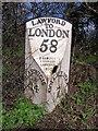 TM0830 : Old Milepost by the A13, Harwich Road, Lawford Parish by JV Nicholls