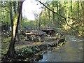 SJ1962 : Wheel pit by the river Alyn by Eirian Evans