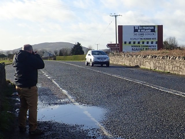 Photographer capturing an image of the Killeen Bridge Anti Brexit Poster