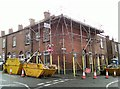 SJ9593 : Scaffolding on corner of Knott Lane and Enfield Street by Gerald England