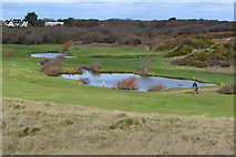 SZ2492 : Ponds on the golf course, Barton on Sea by David Martin