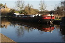 TQ1479 : View of a Dutch barge reflected in the Grand Union Canal near Three Bridges by Robert Lamb