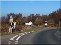 NZ8904 : Plethora of road signs 1 by Christopher Hall
