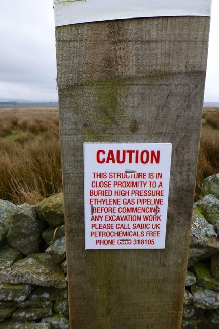 A surprising notice on a bleak hillside © Russel Wills cc-by-sa/2 0