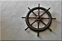 TM5286 : Kessingland, St. Edmund's Church: Wall mounted wheel by Michael Garlick