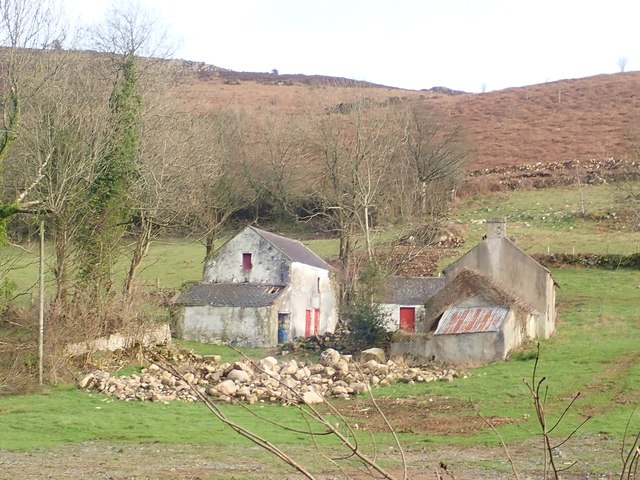 Derelict farmhouse and outbuildings on the western flank of Faughill Mountain