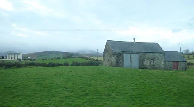 Field barns overlooking the A25 on the eastern outskirts of Kilcoo