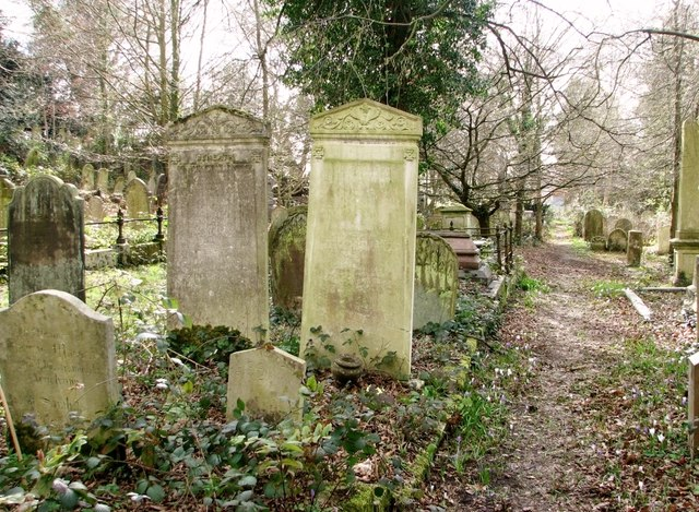 Tall headstones beside the path