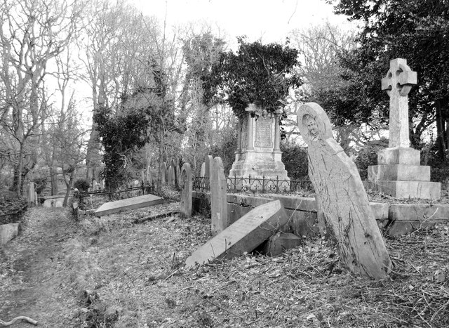 Old gravestones beside the path