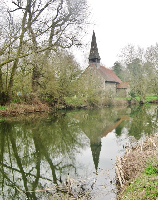 All Saints church, reflected in the water of the Chelmer and Blackwater Navigation Canal, Esex
