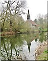 TL8008 : All Saints church, reflected in the water of the Chelmer and Blackwater Navigation Canal, Esex by Derek Voller