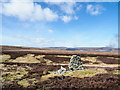 NY8518 : Moorland with cairn above Soulgill Grain by Trevor Littlewood