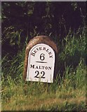 SE9746 : Old Milestone by the B1248, north of Holme on the Wolds by J Harland
