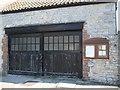 ST6086 : Notice board and wide doors by Neil Owen