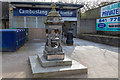 NS6360 : A small fountain outside Cambuslang train station in Glasgow by Garry Cornes