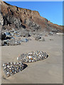 TA2243 : Pudding Stone on the Beach by Des Blenkinsopp