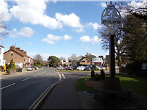 TM4599 : A143 Beccles Road & St. Olaves Village sign by Adrian Cable
