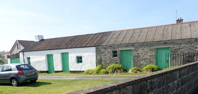 Traditional homestead buildings alongside the A50