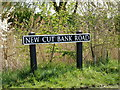 TM4599 : New Cut Bank Road sign by Adrian Cable
