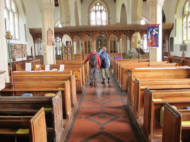 Interior of church at Stoke Gabriel, with ramblers visiting