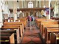 SX8457 : Interior of church at Stoke Gabriel, with ramblers visiting by David Hawgood