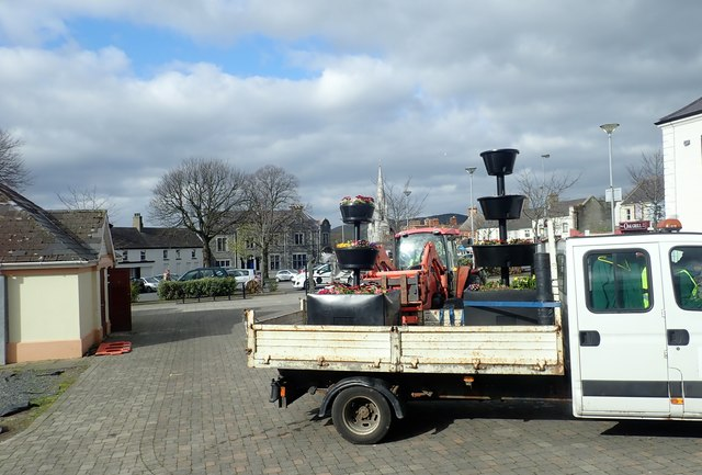 Newry Down and Mourne Council Gardeners setting up flower displays in the Upper Square at Castlewellan