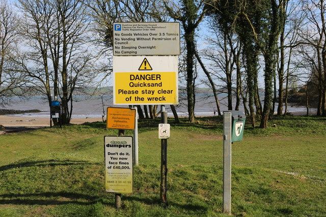 Signs at Nun Mill Bay