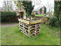SJ4329 : Bee & bug housing at St Simon & St Jude's churchyard by Eirian Evans