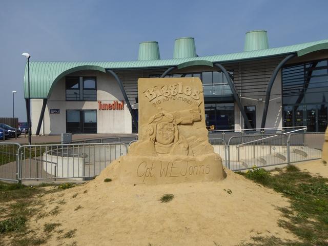 "Sand sculpture outside ""TunedIn"""