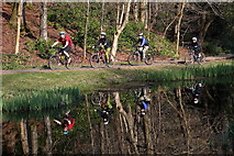 NT4835 : Cyclists in Gala Policies Woodlands by Walter Baxter