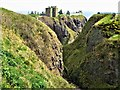 NO8783 : Cleft in rocks at Dunnottar Castle by G Laird