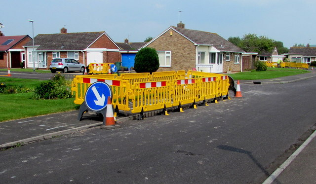 Yellow temporary barriers on the Westfield Drive pavement, Burnham-on-Sea