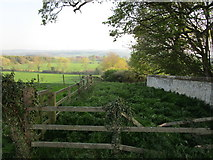 SE8067 : Boundary wall of Langton Hall and view across the valley of the Langton Beck by Jonathan Thacker