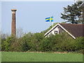 SP3928 : Chimney, Roof and Swedish Flag by Des Blenkinsopp