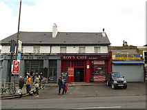 TQ4077 : Roy's Cafe and Shooters Hill Tyres by Stephen Craven