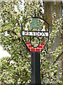 TM5077 : Reydon Village sign by Adrian Cable