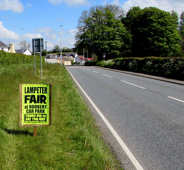 Lampeter Fair advert alongside Llanwnnen Road, Lampeter