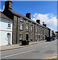 SN5748 : Grade II listed row of three stone houses, High Street, Lampeter by Jaggery