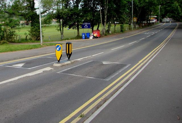 Keep Left sign between speed bumps, Bettws Lane, Newport